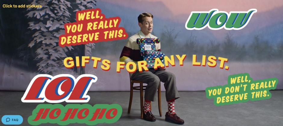 Macaulay Culkin poses with an iguana for Happy Socks' Christmas ad